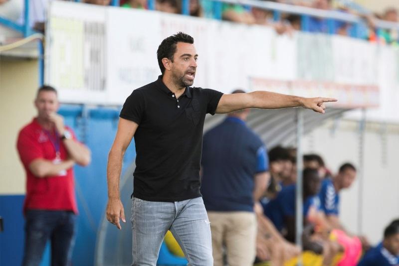 Xavi Hernandez says time not right for Barcelona return