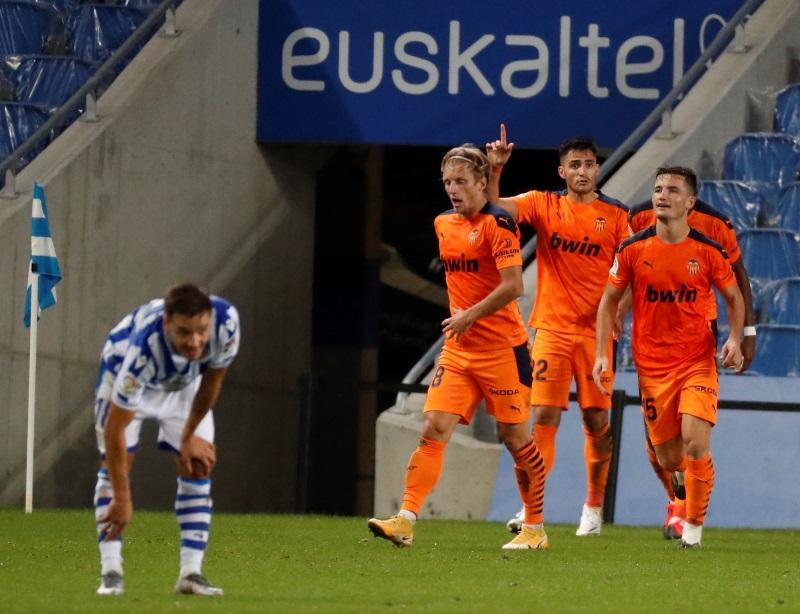 Valencia move top of La Liga with victory at Real Sociedad