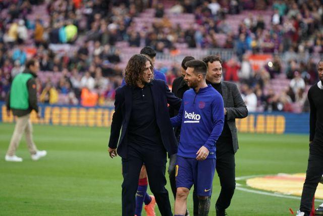Carles Puyol y Lionel Messi