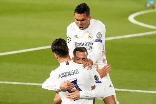 ريال مدريد ماركو أسينسيو ، لوكاس فاسكويز وكارلوس إنريكي كاسيميرو يحتفلون بالهدف خلال دوري أبطال أوروبا UEFA Quar